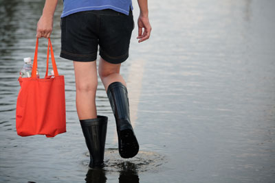 Girl walking through flooded water