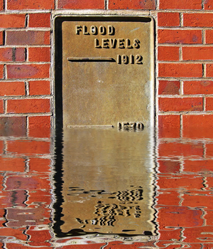 Flood levels sign partially under water